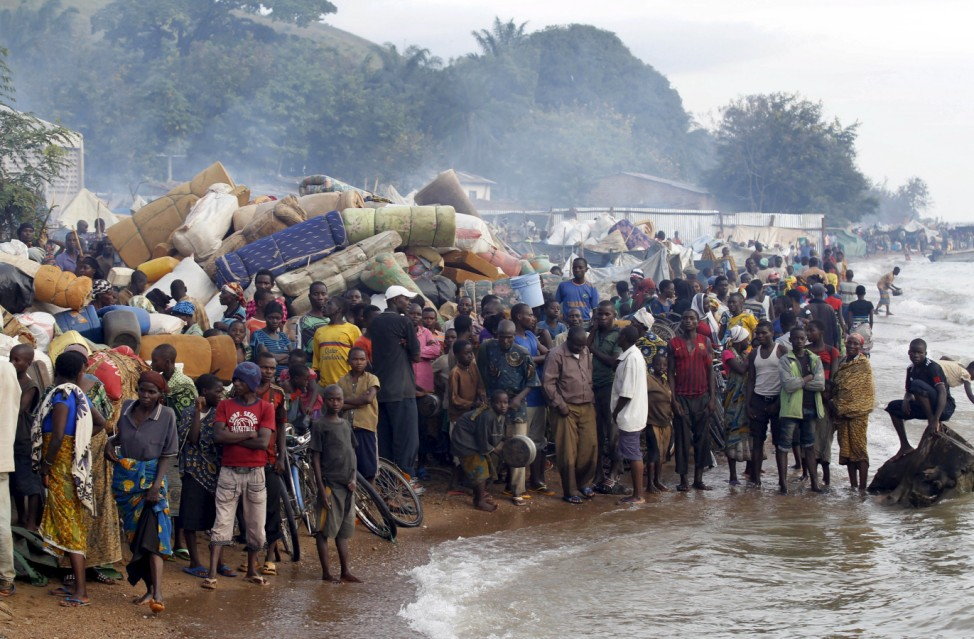 Burundian refugees gather on the shores of Lake Tanganyika in Kagunga village in Kigoma region in western Tanzania