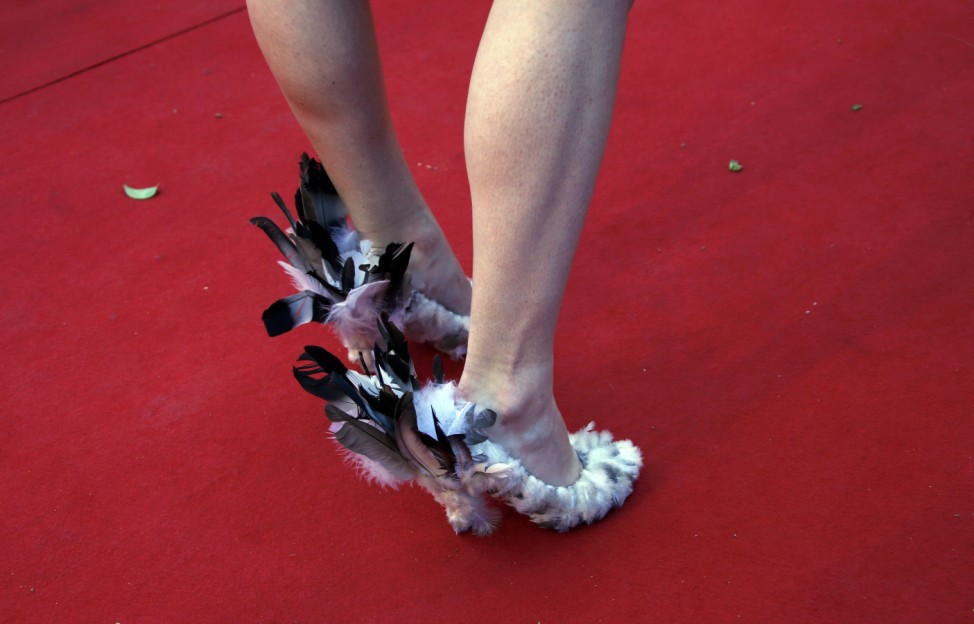 The shoes of a guest are pictured as she poses on the red carpet during arrivals for the screening of the film 'Youth' in competition at the 68th Cannes Film Festival in Cannes