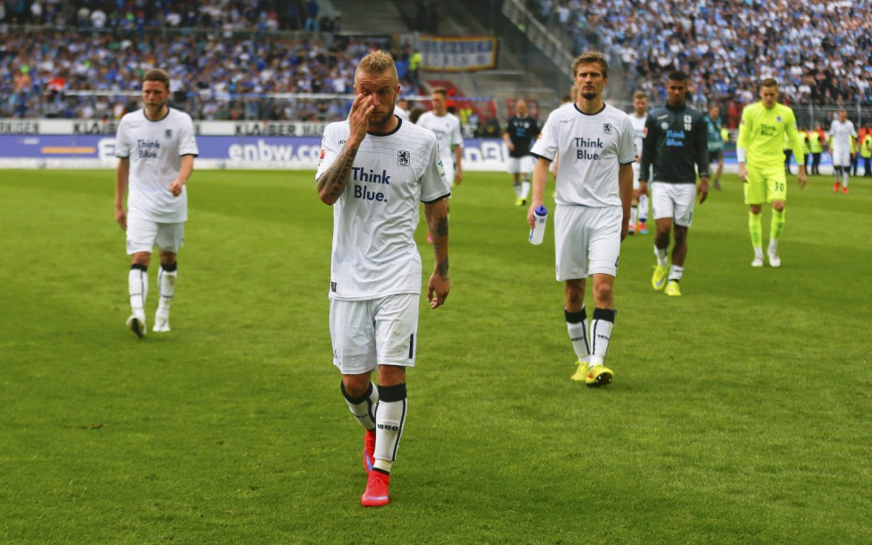 Adlung and his team mates of TSV 1860 Munich leave the pitch after their German second division Bundesliga soccer match against Karlsruhe SC in Karlsruhe