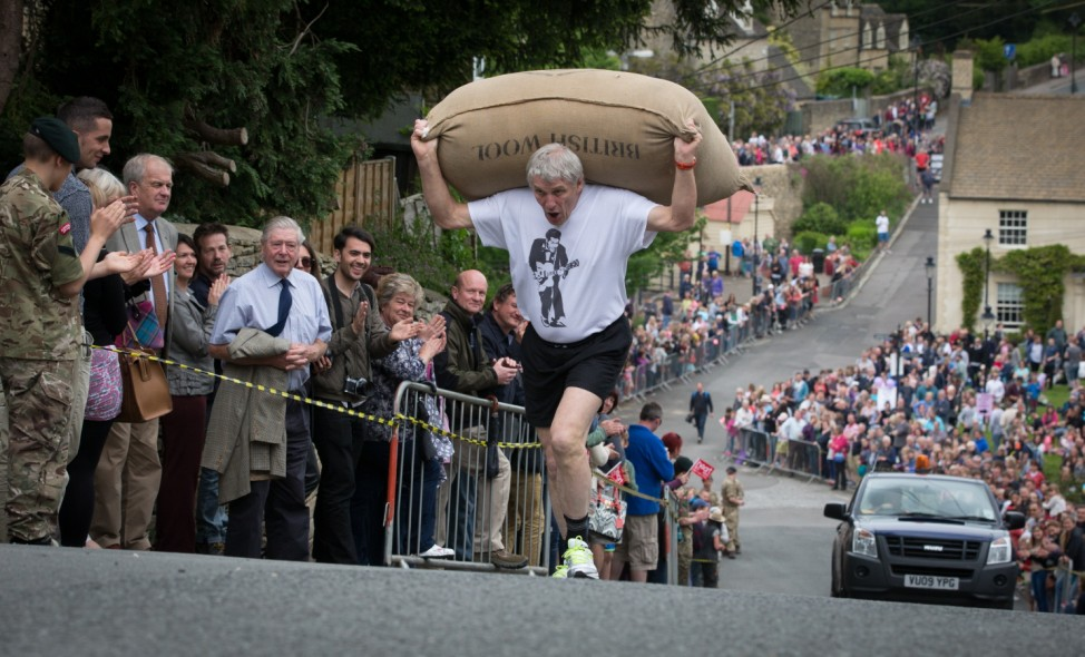 ***BESTPIX*** Traditional Bank Holiday Monday Woolsack Race Takes Place In Tetbury