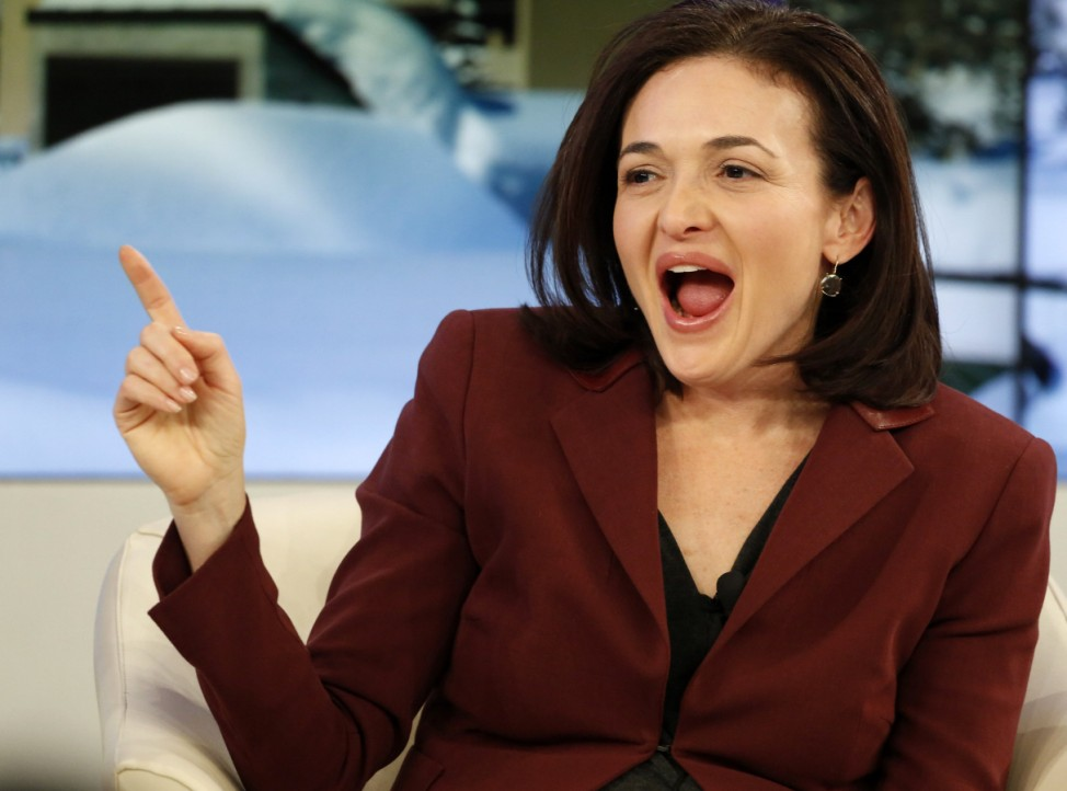 The chief operating officer of Facebook Sandberg reacts during a session at the World Economic Forum in Davos