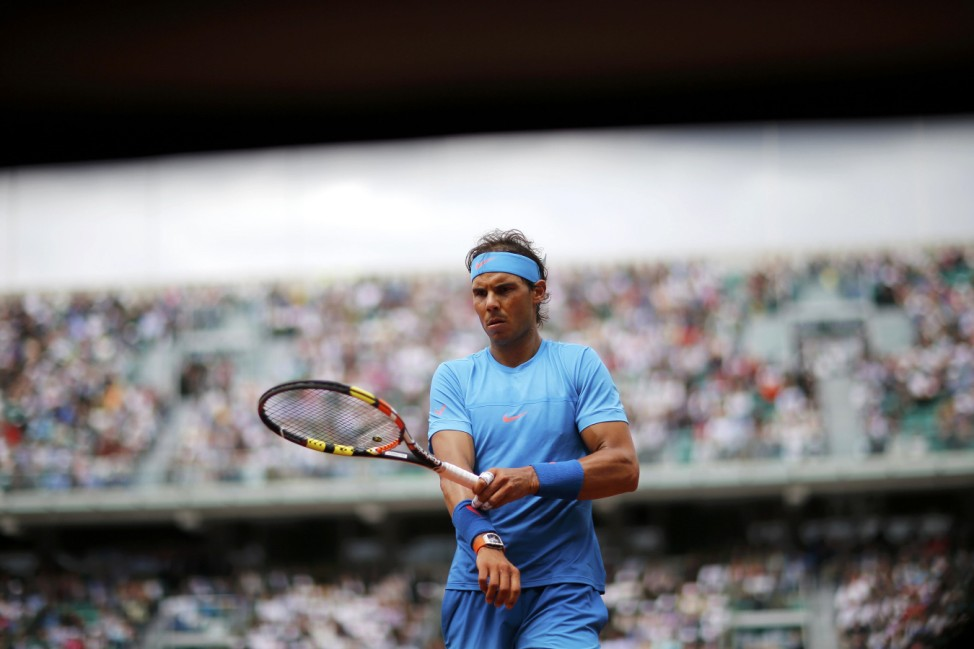 Rafael Nadal of Spain walks on the court during the men's singles match against Quentin Halys of France at the French Open tennis tournament at the Roland Garros stadium in Paris