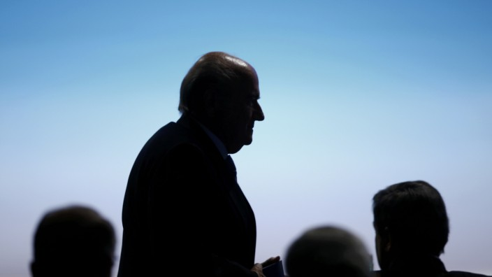 FIFA President  Blatter walks past the podium at the UEFA congress in Vienna