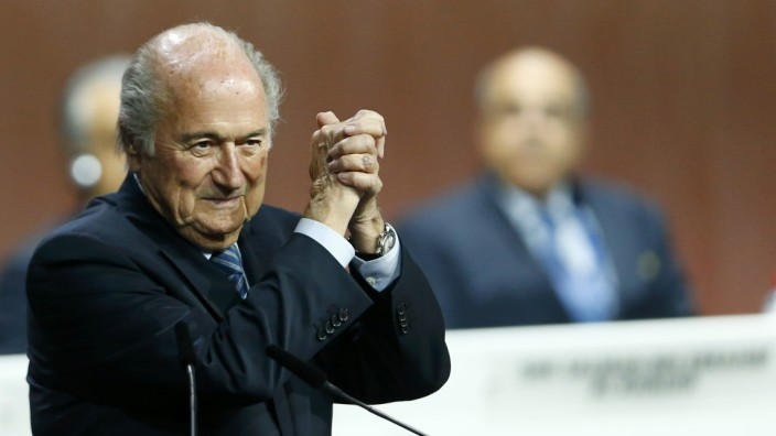 FIFA President Blatter gestures after he was re-elected at the 65th FIFA Congress in Zurich