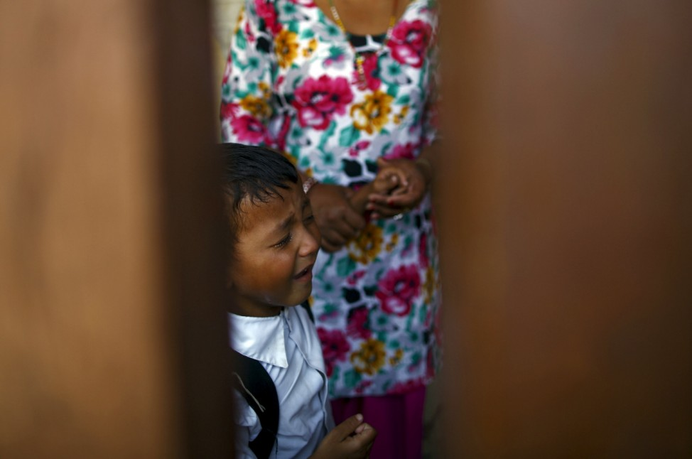 Ukesh Tolangay cries after being dropped off by his mother at school in Bhaktapur