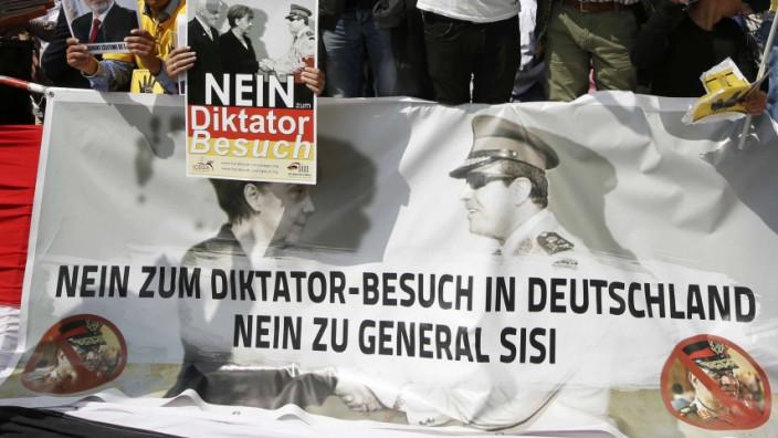 Demonstrators protest against Egypt's President Sisi opposite the Chancellery in Berlin