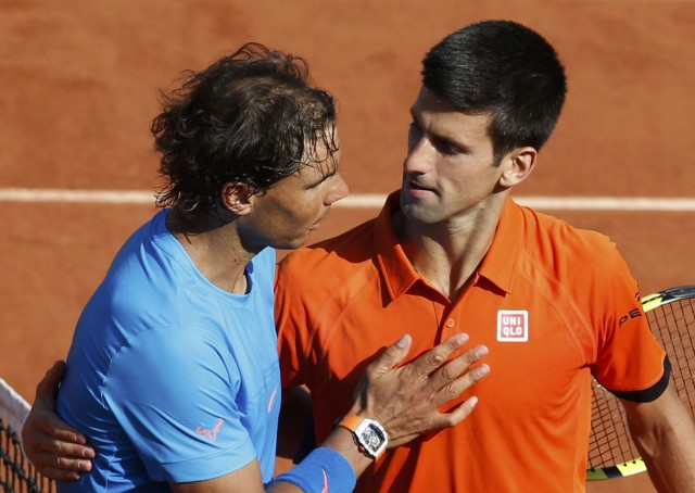Novak Djokovic of Serbia shakes hands with Rafael Nadal of Spain after winning their men's quarter-final match during the French Open tennis tournament at the Roland Garros stadium in Paris