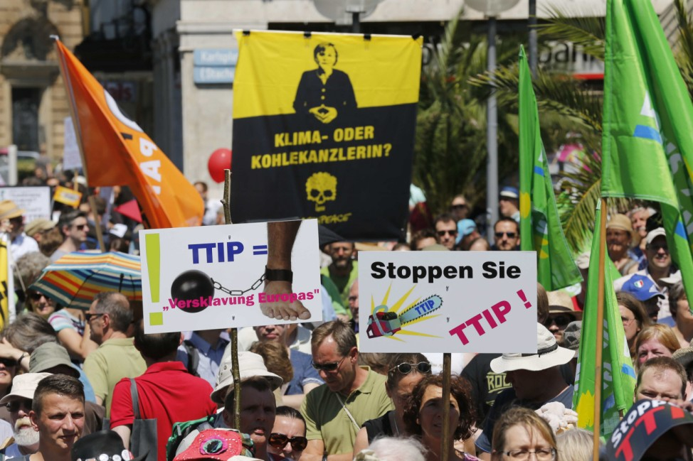 People demonstrate against TTIP during protest rally prior to the G7 summit in Munich