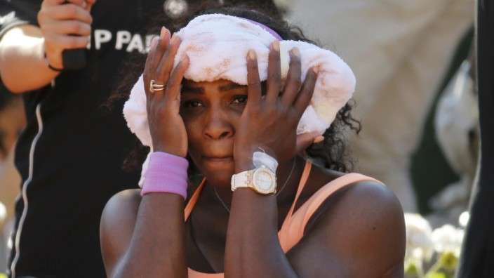 Serena Williams of the US sits during a break in her women's semi-final match against Timea Bacsinszky of Switzerland at the French Open tennis tournament at the Roland Garros stadium in Paris