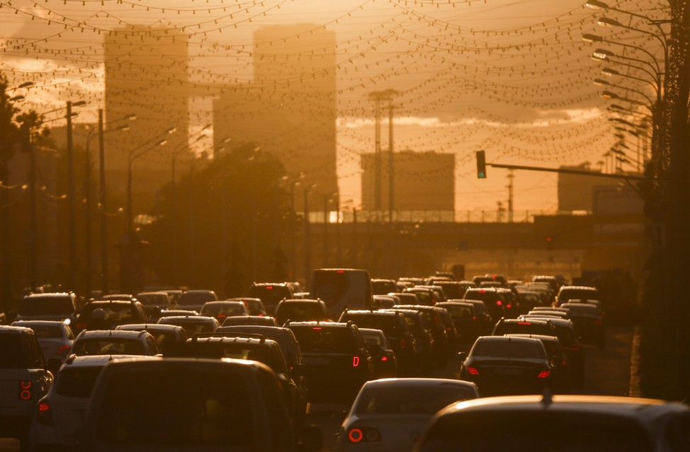 Cars are stuck in traffic jam during sunset in Moscow