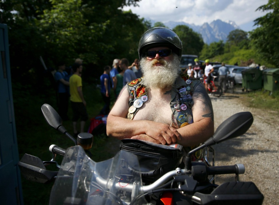 G7 opponent and member of motorcycle club 'Kuhle Wampe' stands in front of protestor's camp on outskirts of Garmisch-Partenkirchen