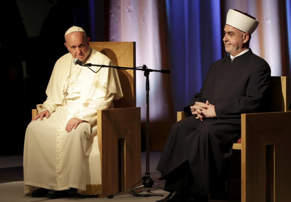 Pope Francis attends an ecumenical and interreligious meeting at a Franciscan student centre in Sarajevo
