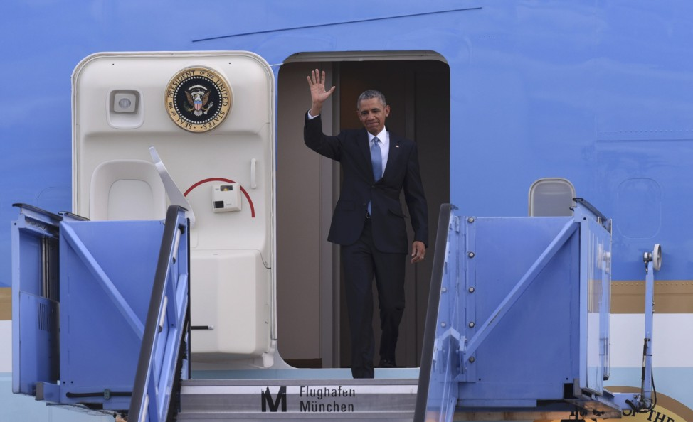 U.S. President Obama waves as he leaves the plane after landing in Munich airport
