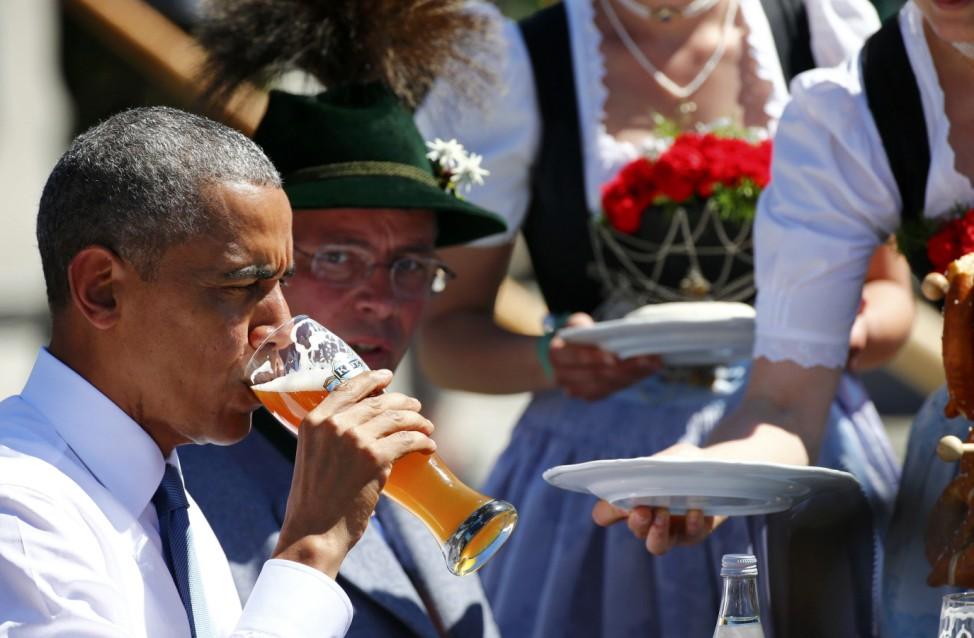 U.S. President Obama drinks beer as he visits Kruen
