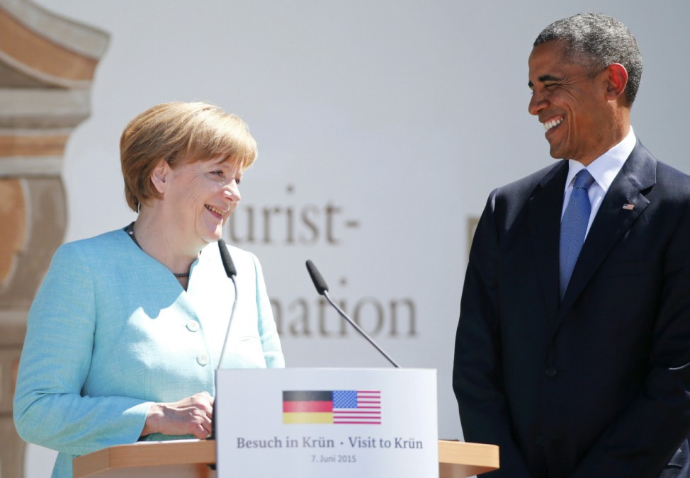 German Chancellor Merkel and U.S. President Obama prepare to make speeches after signing the guest book in Kruen