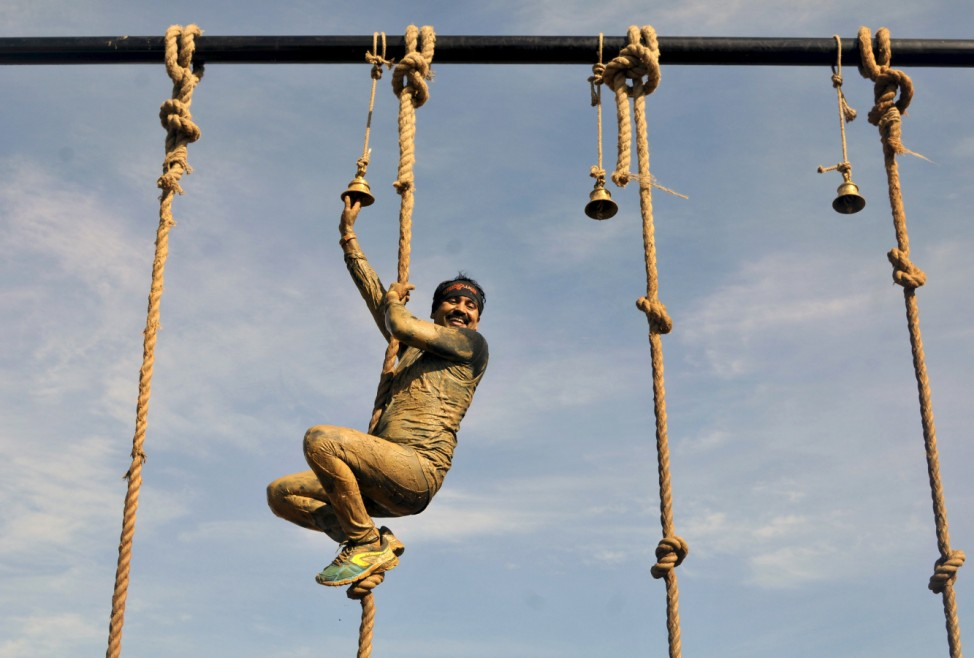 Competitor reacts upon completing an endurance task as he participates in the Alpha League Races in Bengaluru