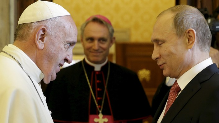 Russian President Putin meets Pope Francis during a private meeting at Vatican City