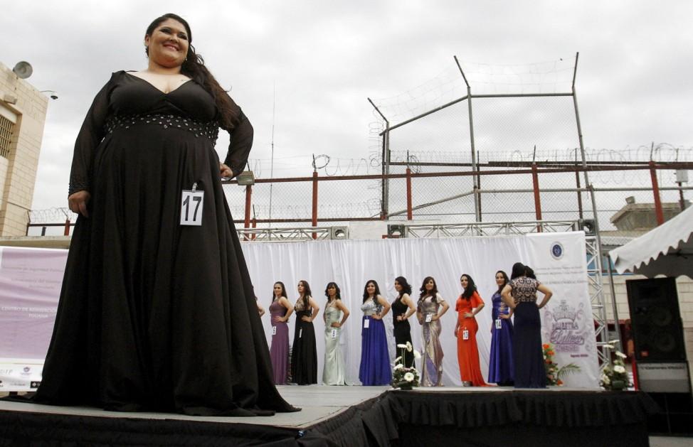 An inmate poses for a picture as she takes part in a beauty pageant for female inmates at the Baja California state prison in Tijuana