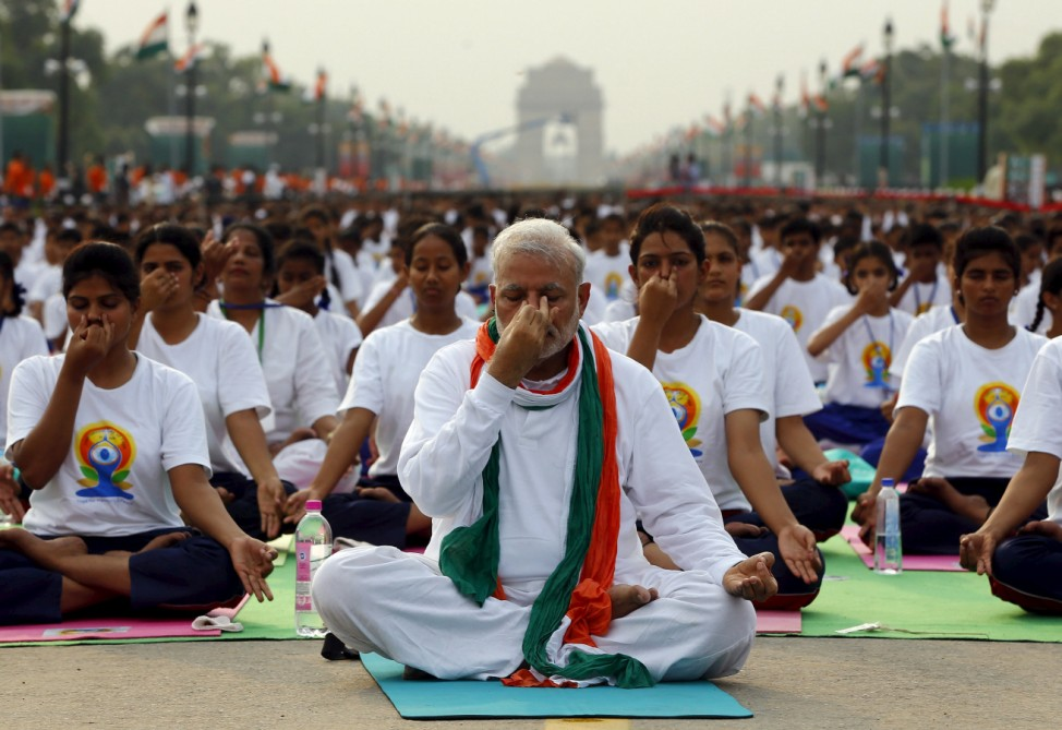 India's Prime Minister Modi performs yoga with others during a yoga camp to mark the International Day of Yoga, in New Delhi