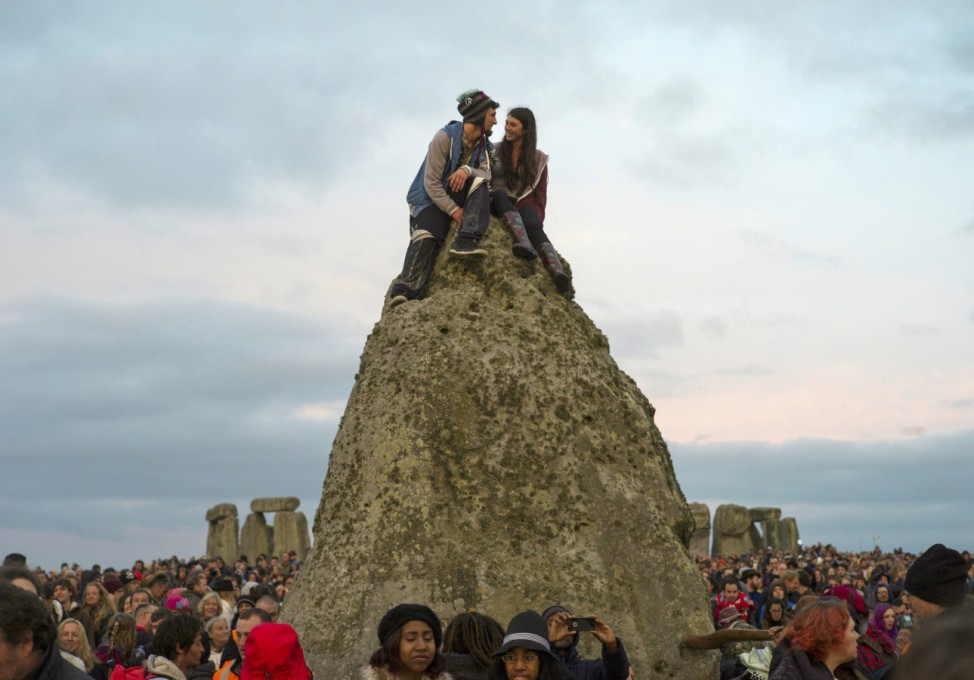 Revellers celebrate the summer solstice at Stonehenge on Salisbury Plain