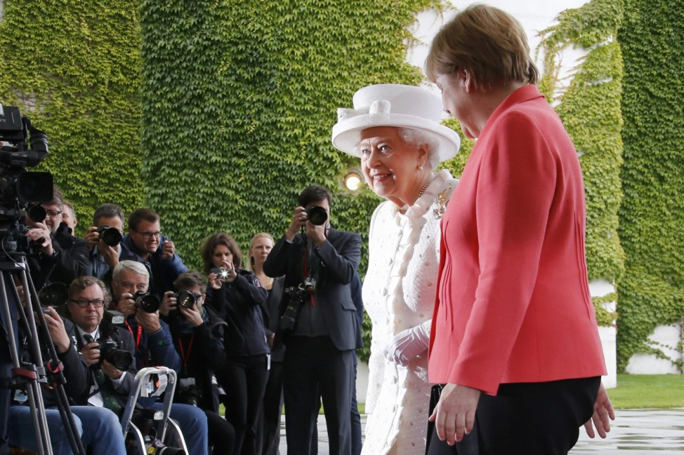 Britain's Queen Elizabeth and Prince Philip is greeted by German Chancellor Merkel at Chancellery in Berlin