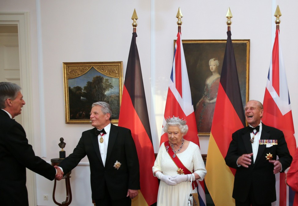 Britain's Queen Elizabeth and Prince Philip greet Britain's Foreign Secretary Hammond prior to state banquet in Berlin
