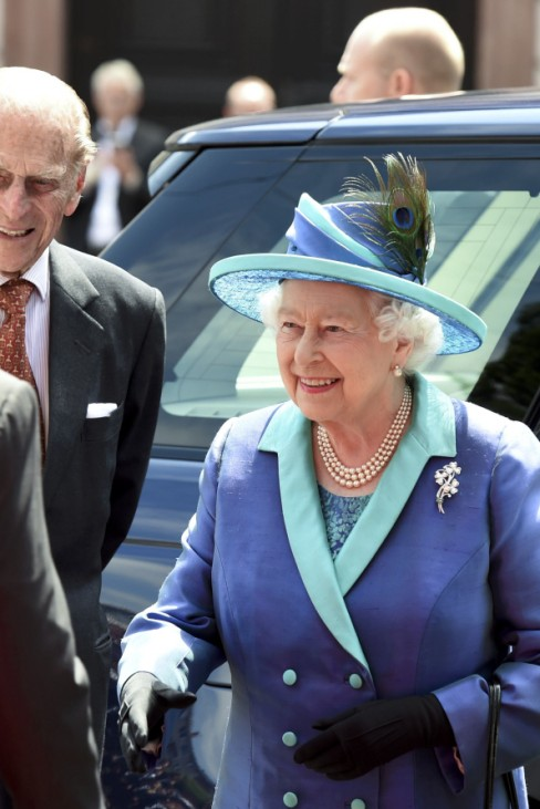 Britain's Queen Elizabeth and Prince Philip are greeted by Frankfurt lord mayor Feldmann and Hesse's state Prime Minister Bouffier outside St. Paul's Church in Frankfurt