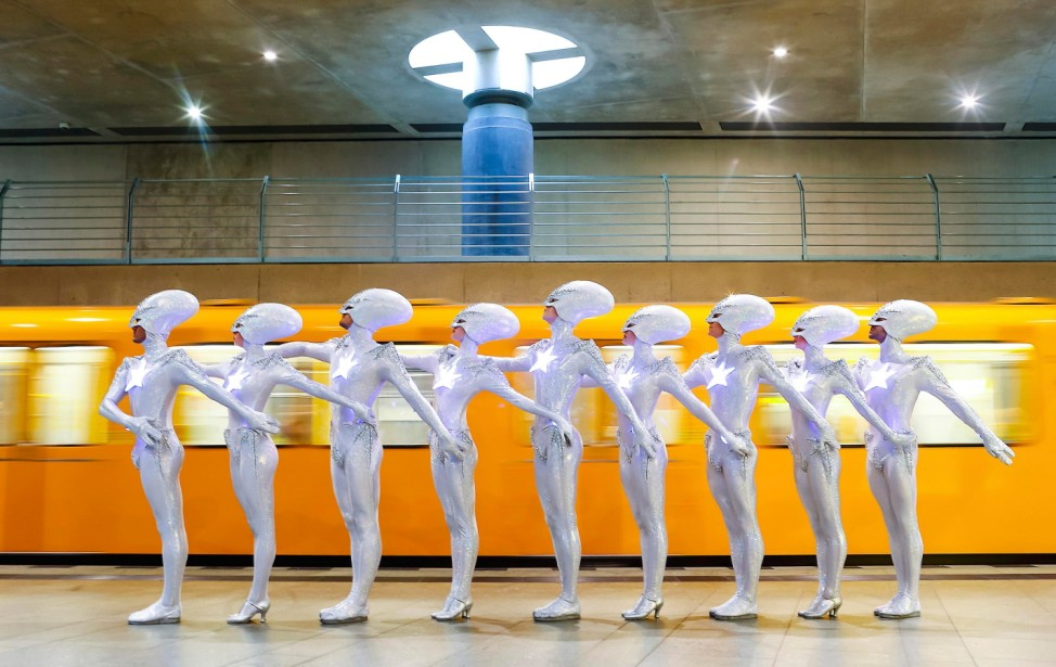 Dancers of Friedrichstadt-Palast from show 'THE WYLD' pose during a photocall at underground train station in Berlin