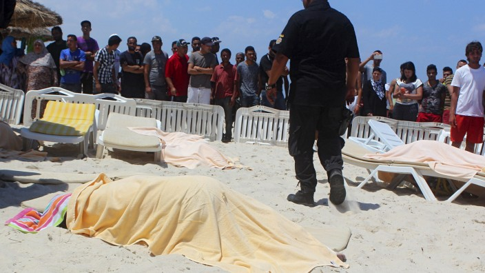 The body of a tourist shot dead by a gunman lies near a beachside hotel in Sousse, Tunisia