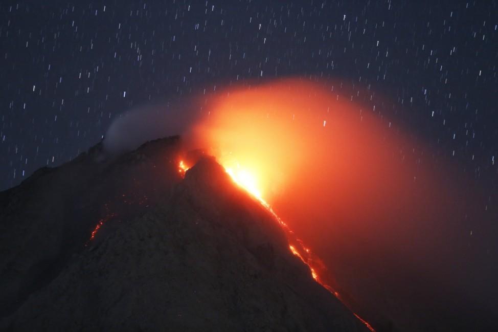 Lava flows from Mount Sinabung volcano during an eruption as seen from Tiga Serangkai village in Karo Regency