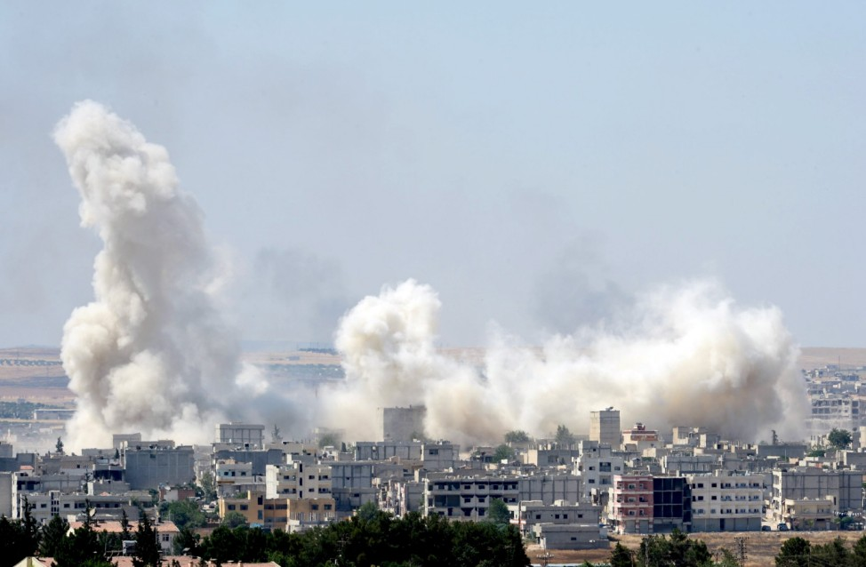 Smoke rises in the Syrian town of Kobani, as pictured from the Turkish side of the border near Suruc, Sanliurfa province, Turkey