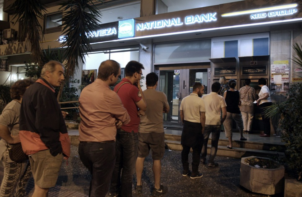 People withdraw money from ATM of Greece's National Bank in Athen