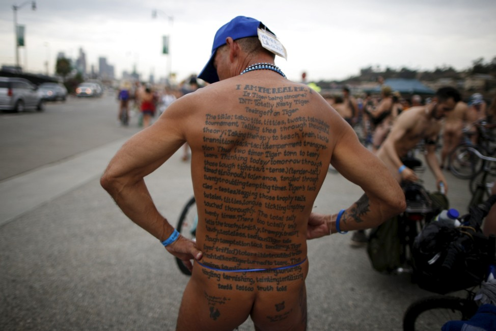 A tattooed participant takes part in the World Naked Bike Ride in Los Angeles