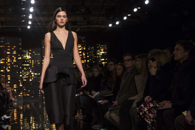 Kendall Jenner presents a creation from the Donna Karan New York Fall/Winter 2015 collection at New York Fashion Week
