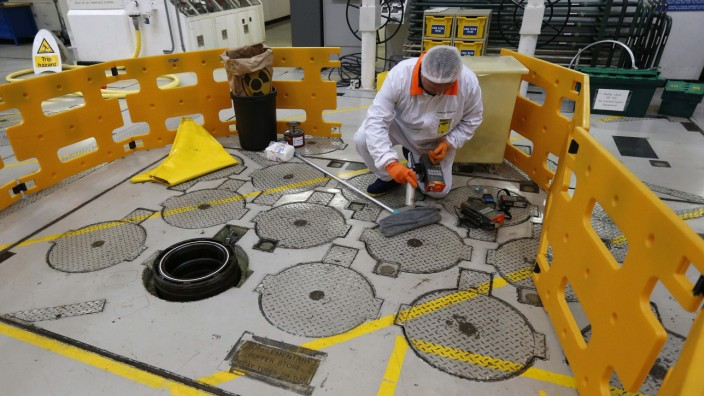 An environmental safety monitor carries out contamination checks in the charge hall inside EDF Energy's Hinkley Point B nuclear power station in Bridgwater, southwest England
