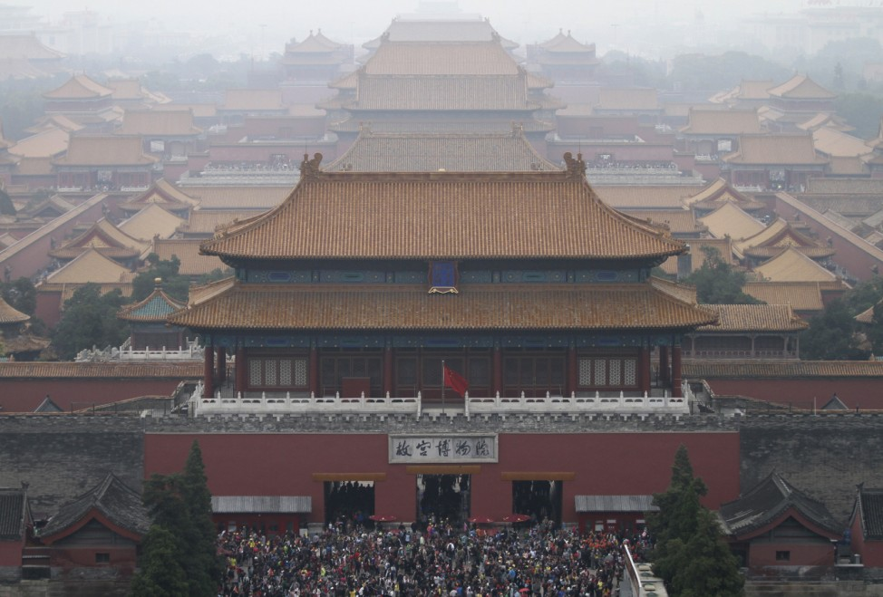 Tourists visit the Forbidden City on the third day of the seven-day national day holiday, among thick haze in Beijing; forbidden city