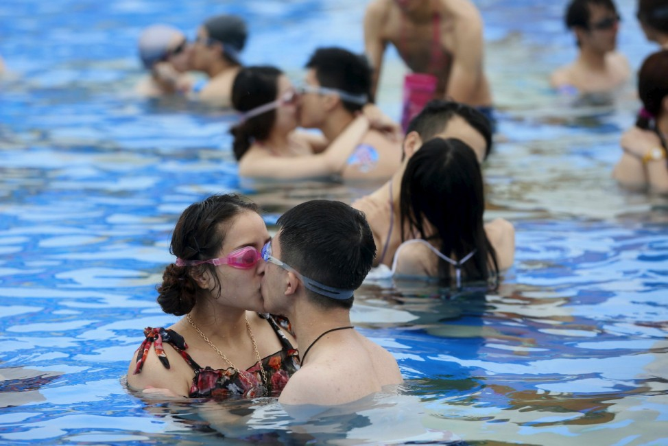 Couples kiss in a swimming pool during a kissing contest in Shanghai