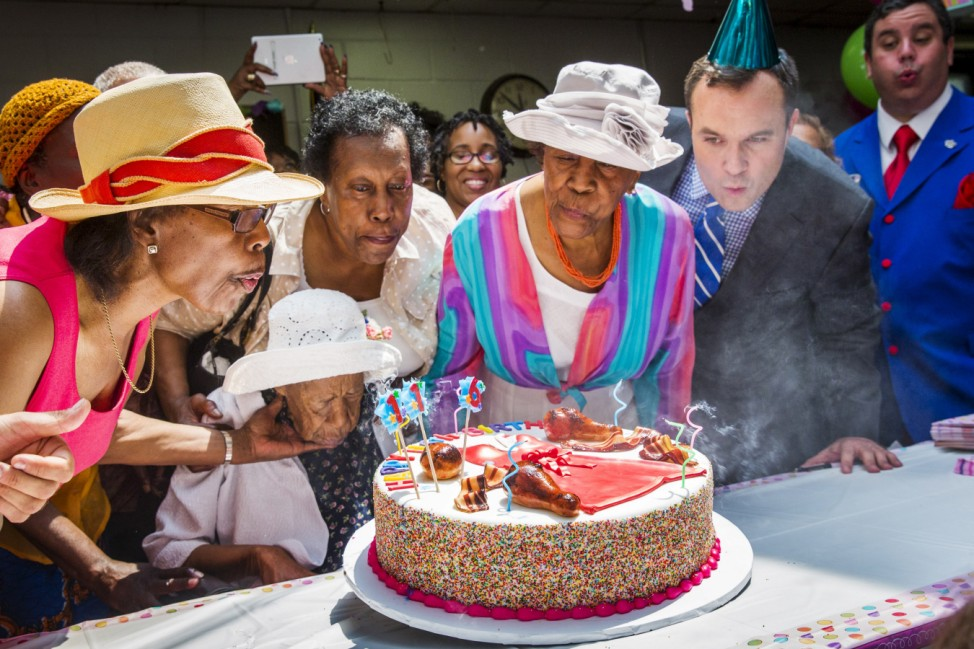 Susannah Mushatt Jones (seated), known as 'Miss Susie' celebrates her 116th birthday with family members, local dignitaries, and friends in the Brooklyn borough of New York