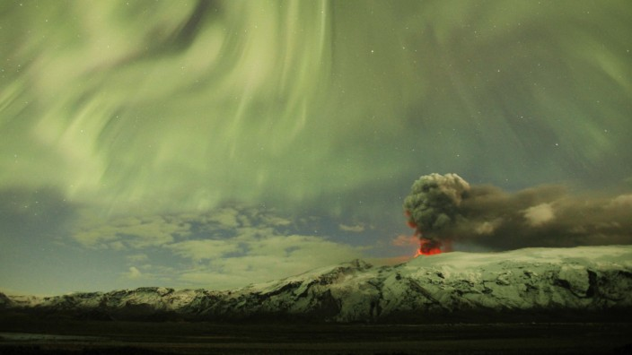File photo of the Northern Lights as seen above the ash plume of Iceland's Eyjafjallajokull volcano in the evening