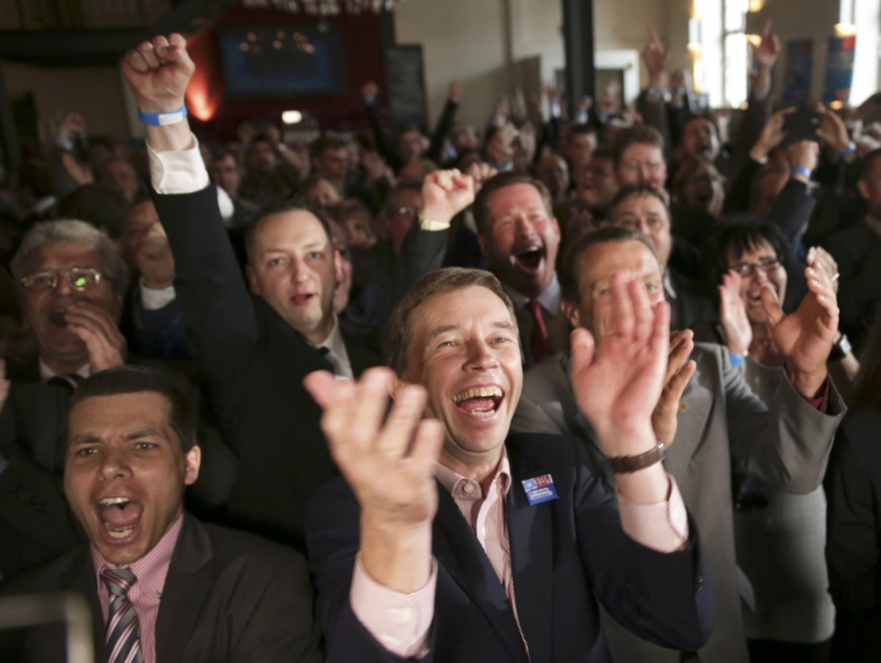 Lucke, leader of Alternative for Germany (AfD) reacts to exit polls at the party post election venue in Potsdam