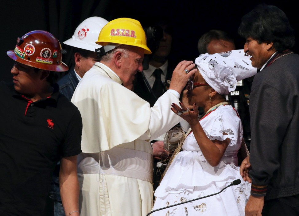 Pope Francis blesses a woman as Morales looks on, during a World Meeting of Popular Movements in Santa Cruz