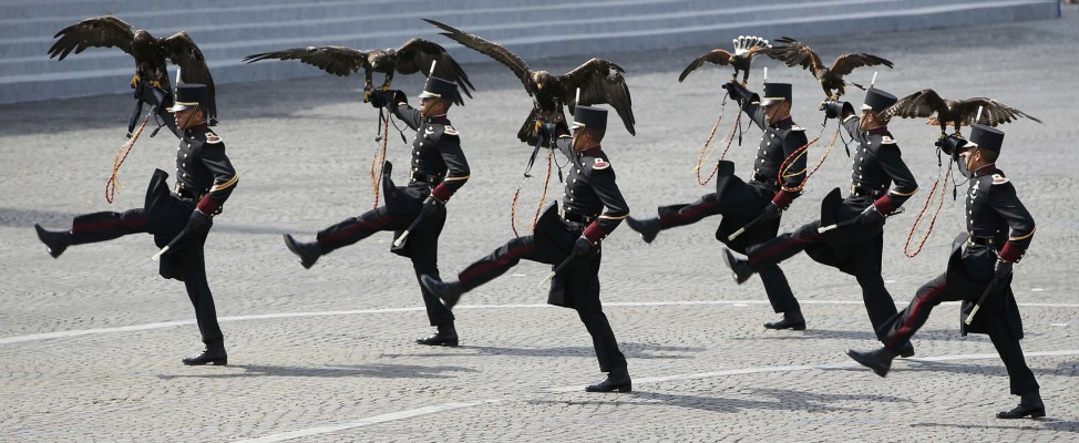 Falconers of the Mexican army hold falcons as they march during the traditional Bastille Day military parade on the Place de la Concorde in Paris