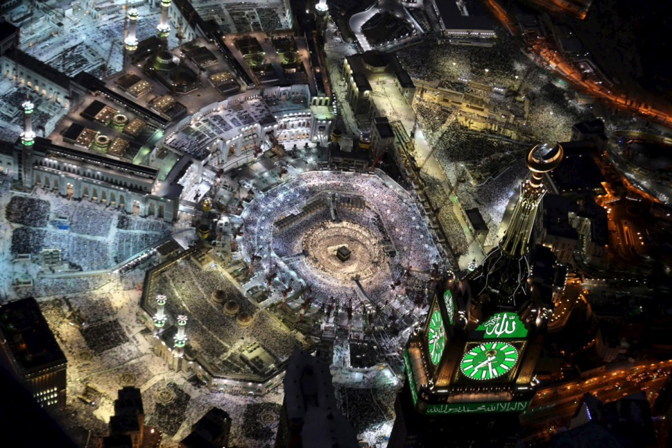 Aerial view of  Muslim worshippers praying in Grand mosque, holiest place in Islam, in holy city of Mecca during Ramadan