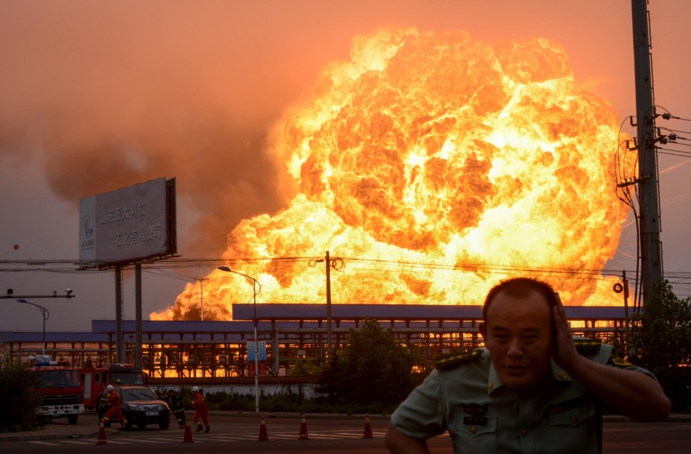 An explosion at a petrochemical plant is seen in Rizhao, Shandong province