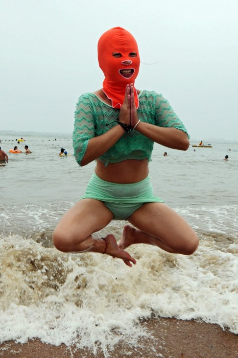 Chinese swimmers have facekinis to protect faces
