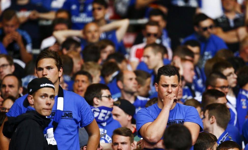 Hamburg SV's fans react after losing their German Bundesliga first division soccer match against VFB Stuttgart in Stuttgart