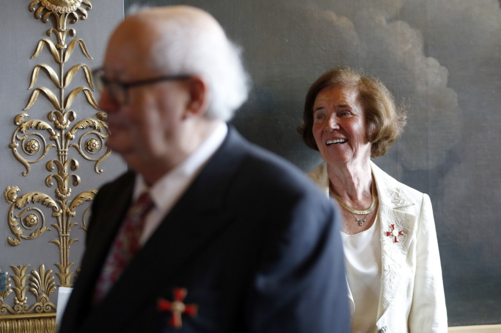 Nazi hunters Beate Klarsfeld and Serge Klarsfeld react after being awarded by German ambassador to France at her residence in Paris
