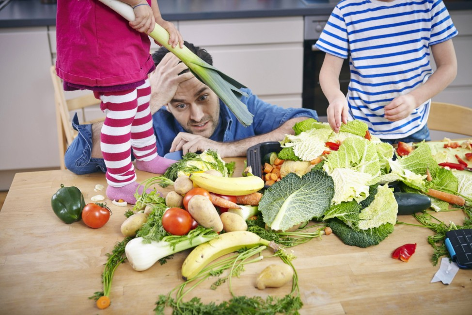 Desperate father trying to preparie food in chaos model released Symbolfoto property released PUBLIC