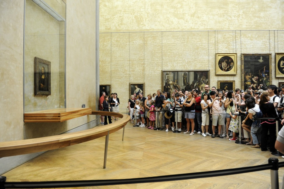 Tourists take souvenir photos of Italian painter Leonardo da Vinci's famed portrait Mona Lisa at the Louvre Museum in Paris; mona lisa