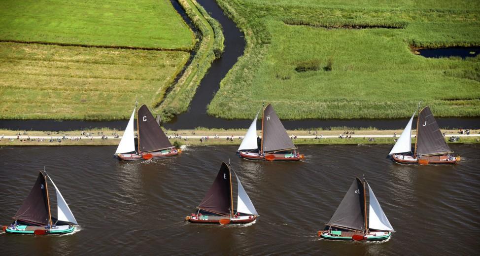 Traditional Frisian yachts sail near Eernewoude